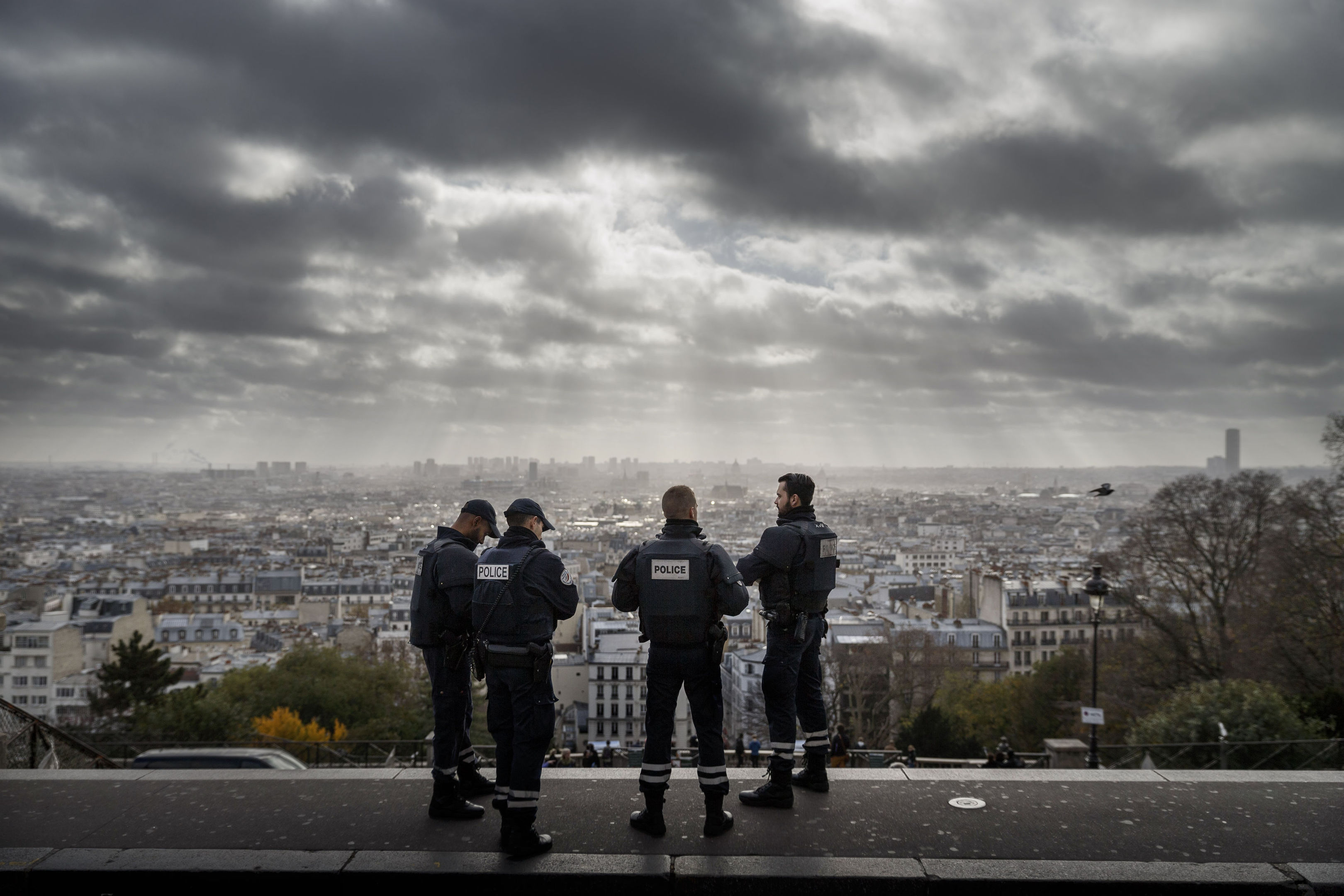 French Police officers on guard at Sacre Coeur, one of Paris' top tourist attractions, in the wake of attacks.