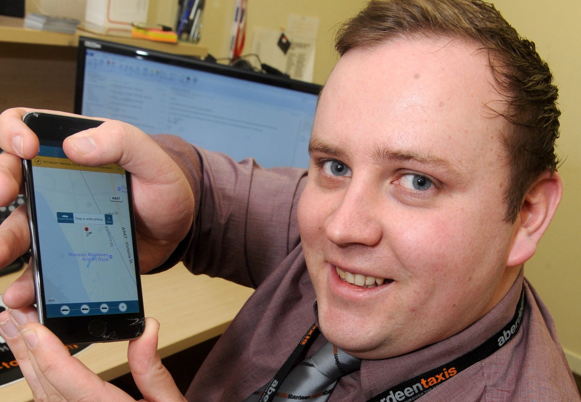 Chris Douglas, a director of Aberdeen Taxis Ltd, showing off the new app which is due to launch next month. picture by chris sumner