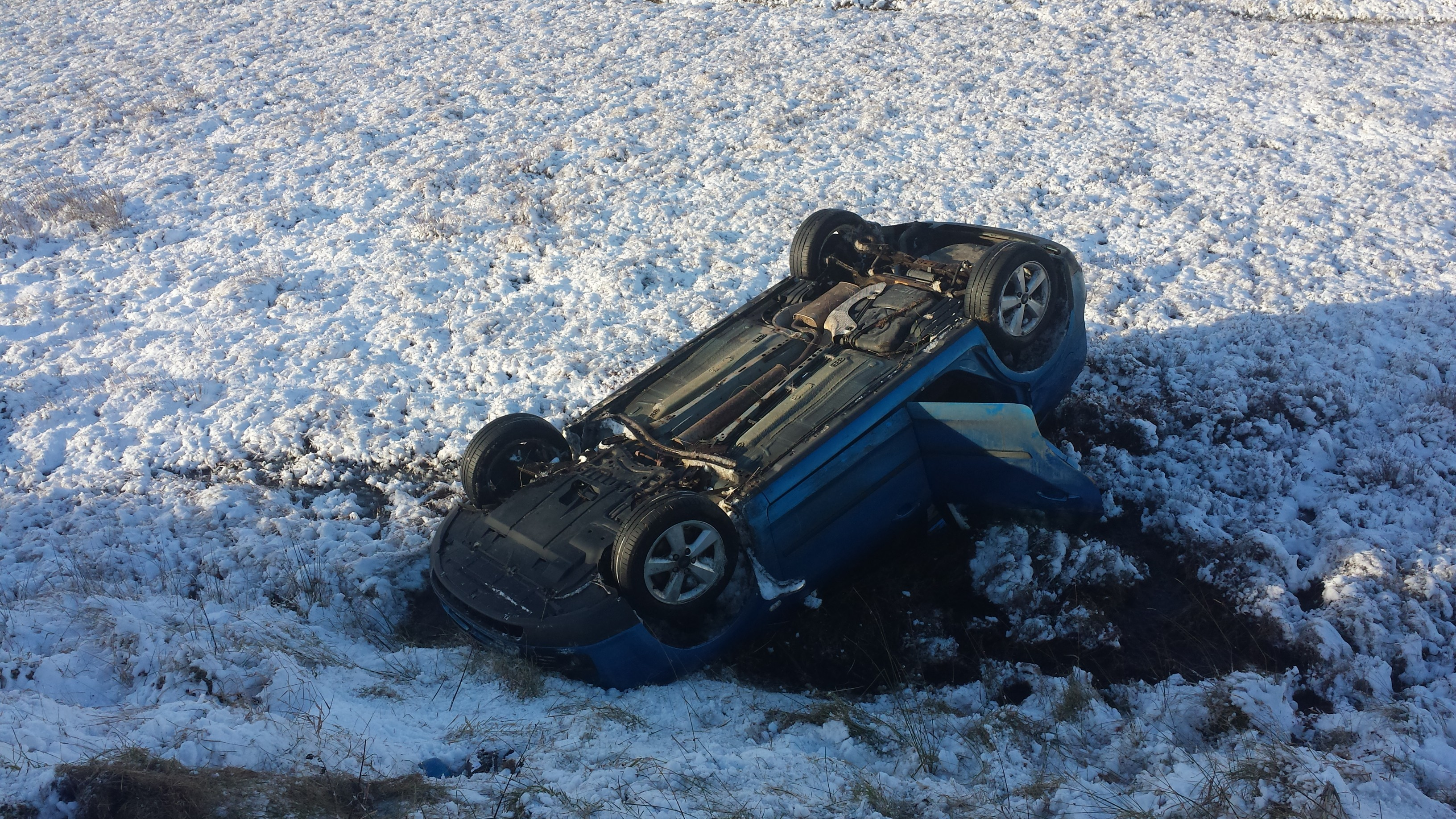 The family were trapped in their overturned car until passersby helped them out.