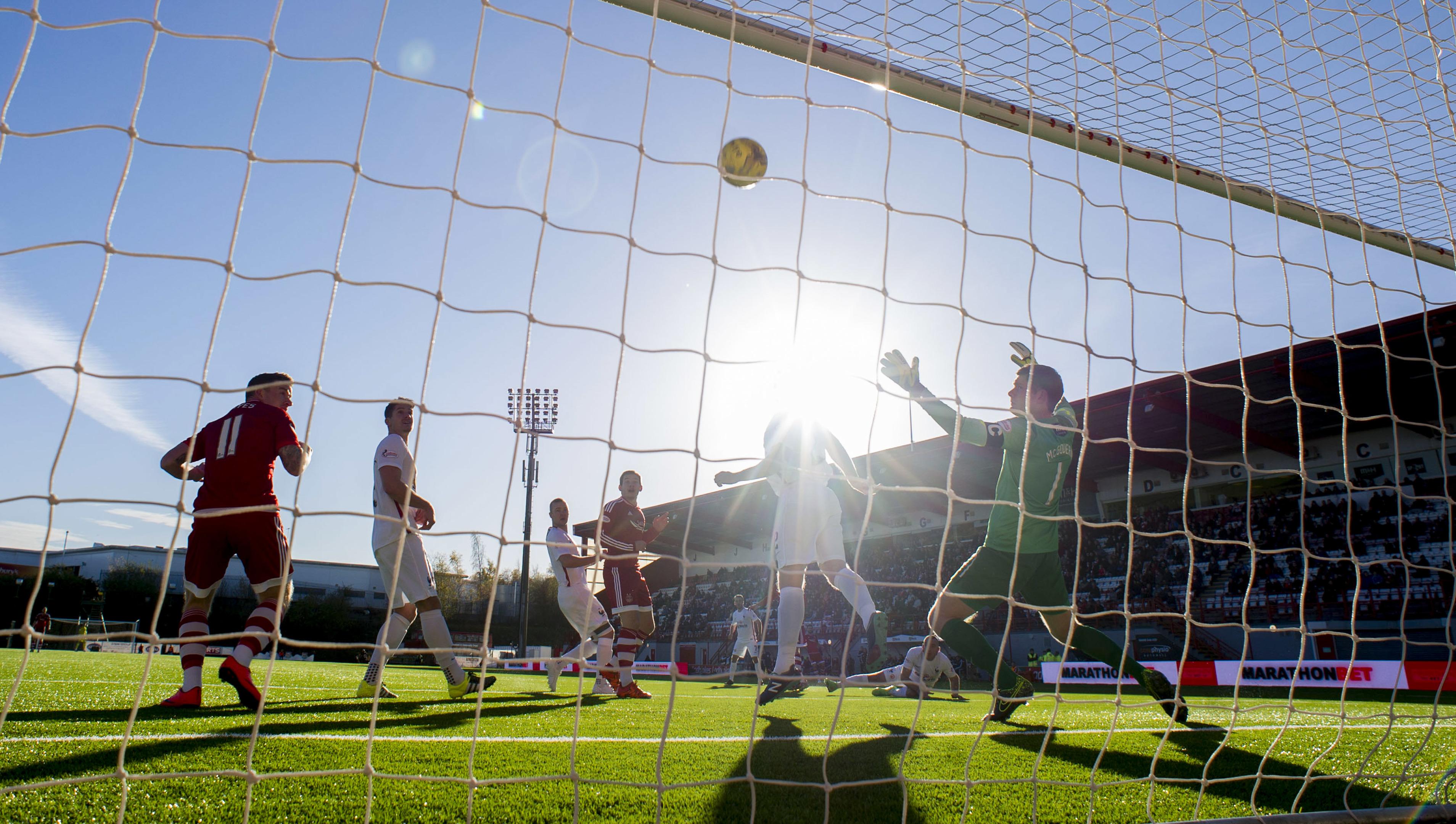 Aberdeen's Kenny McLean (partially hidden) opens the scoring against Hamilton at New Douglas Park.