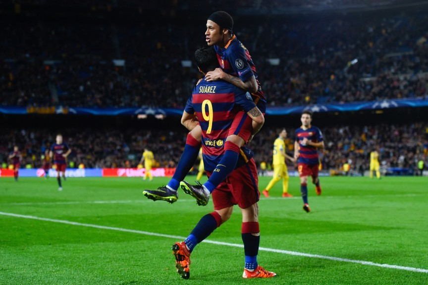 Neymar (celebrates with his team mate Luis Suarez after scoring his team's third goal against FC BATE Borisov.