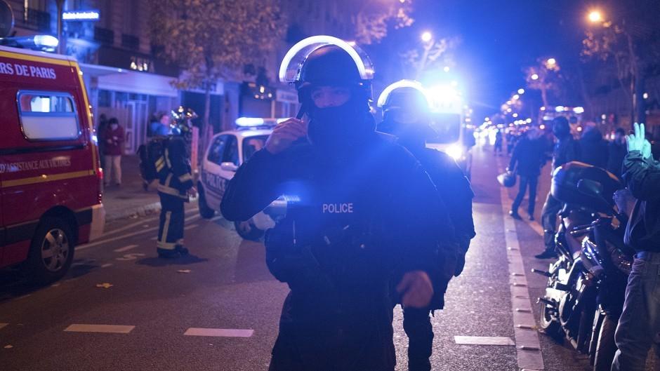 Elite police officers arrive outside the Bataclan theatre in Paris (AP)