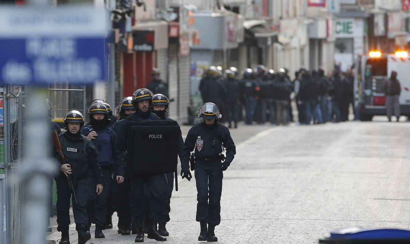 Special police forces walk through Saint-Denis, a northern suburb of Paris,