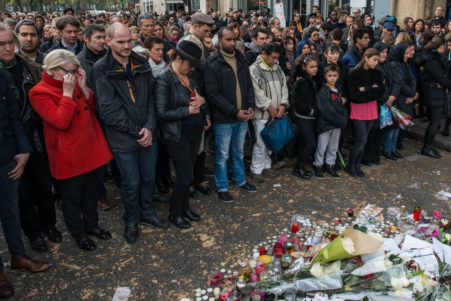People observe a minute of silence near the Bataclan concert hall.