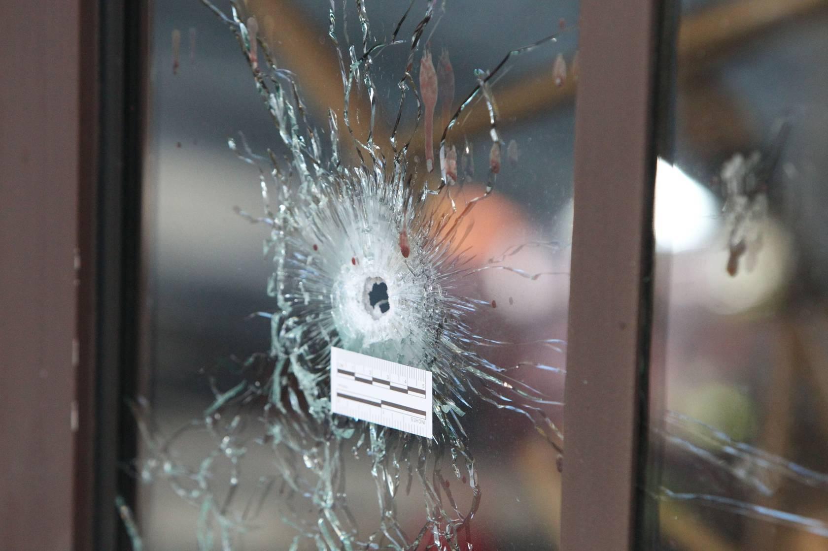 Bullet holes are visible in La Casa Nostra pizzeria.