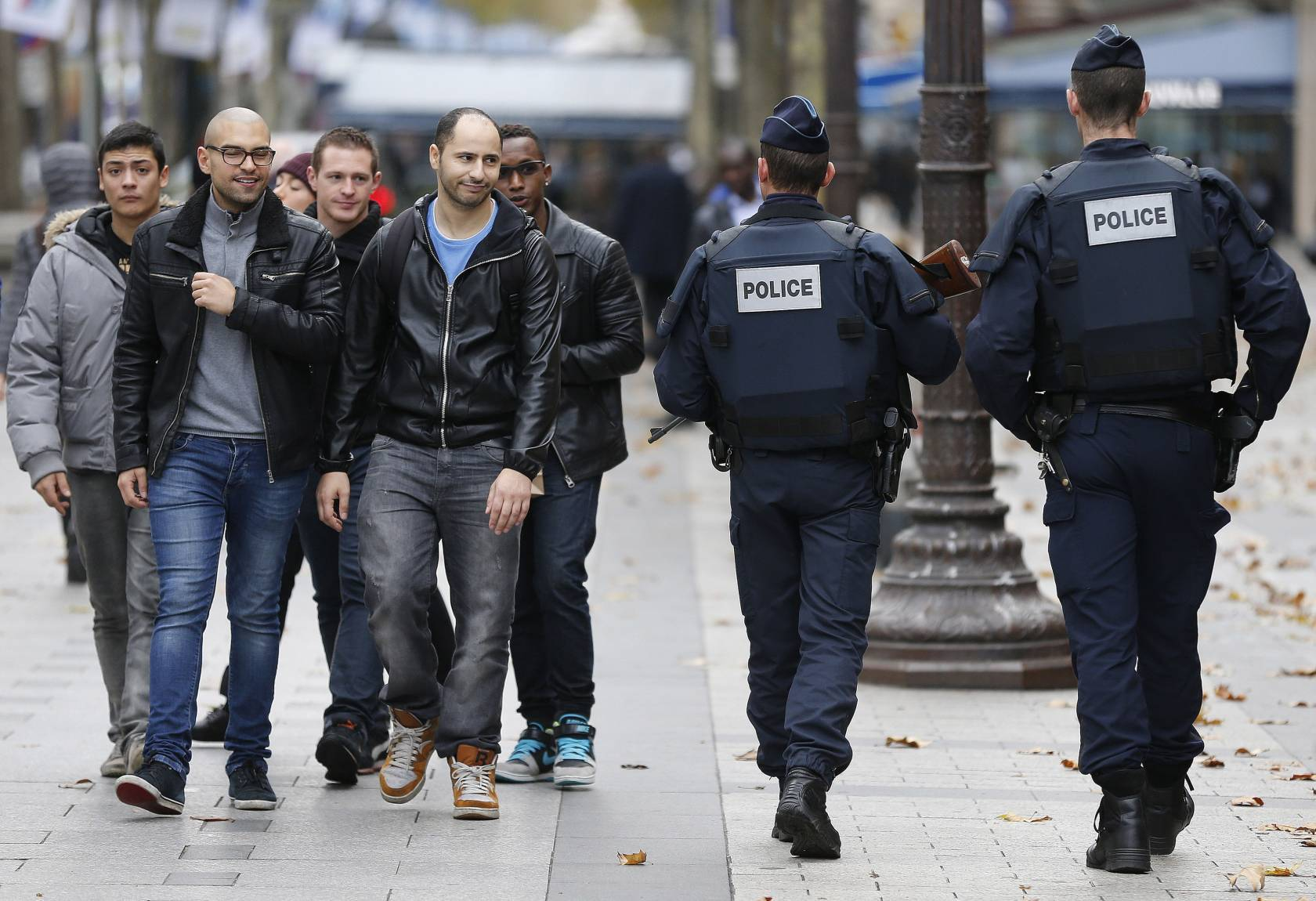 Police forces patrol on the Champs Elysee in Paris.