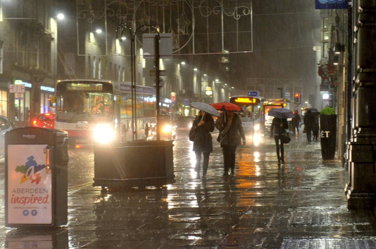 Late night shoppers on Union Street braved the torrential when Storm Abigail hit Aberdeen last night. Picture by Heather Fowlie.