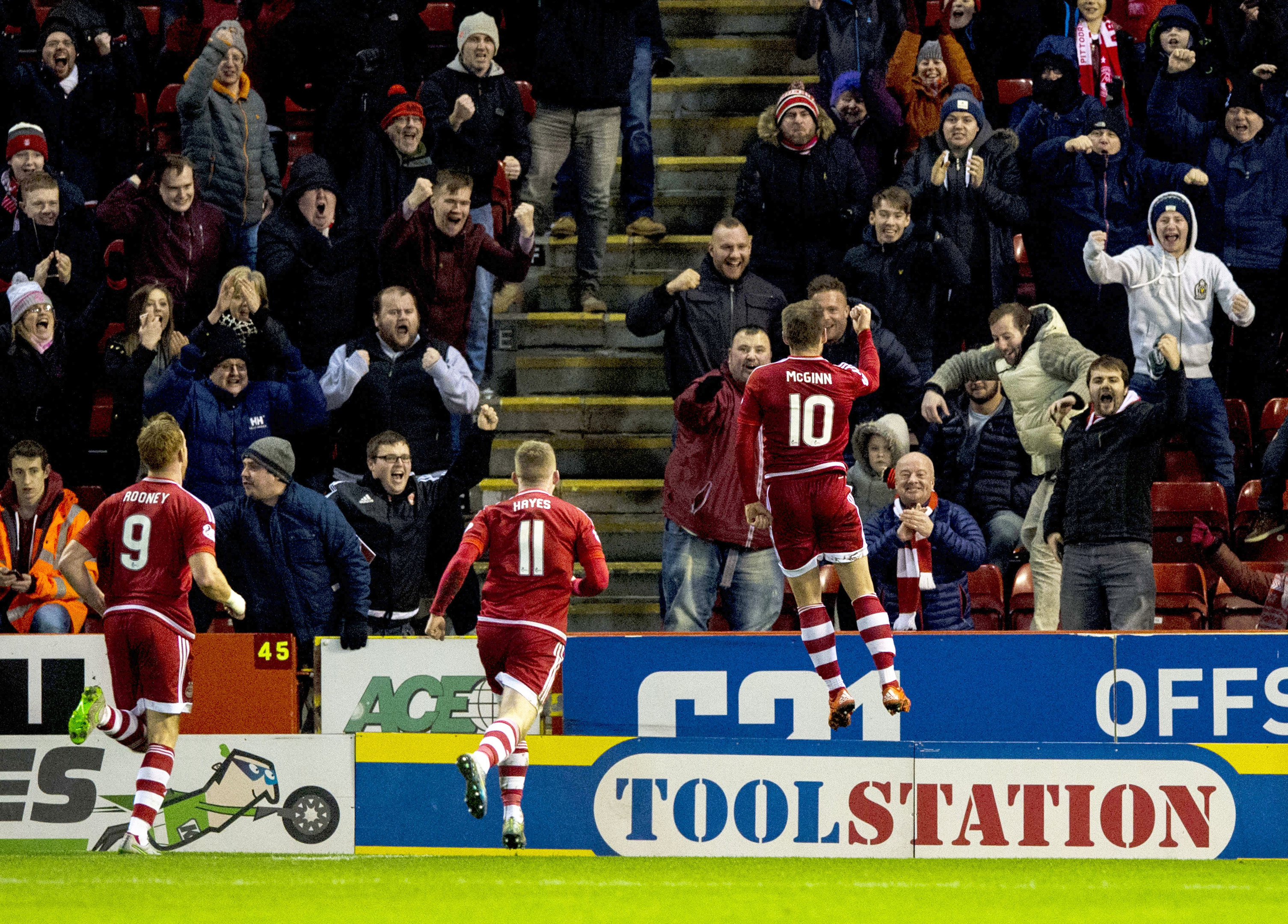 Niall McGinn celebrates his goal against County with the Dons fans