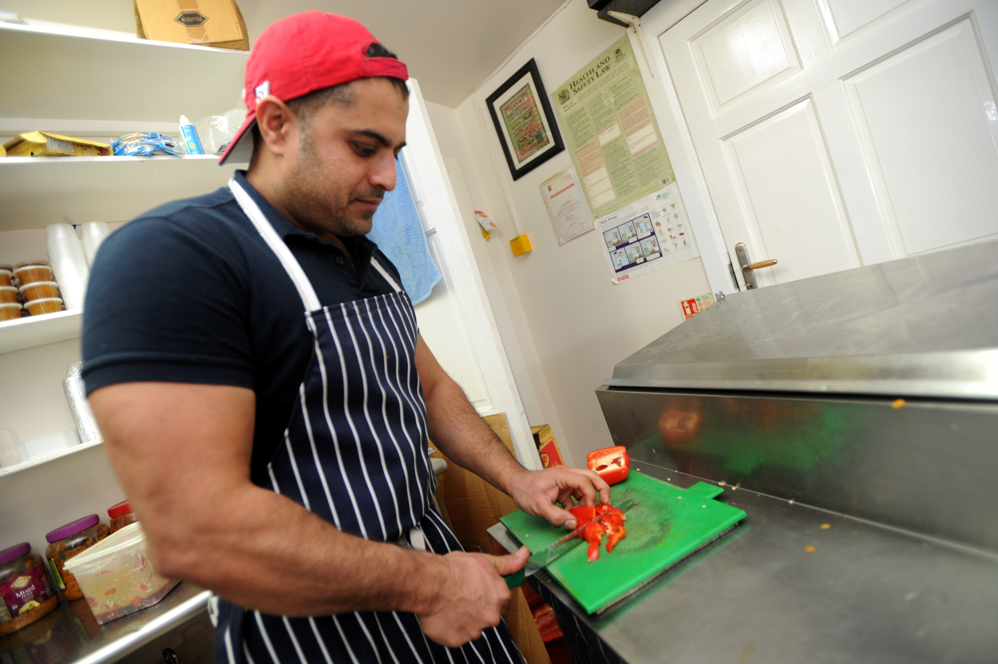 IN ACTION:  Food is prepared at Cafe Bombay in Peterculter.