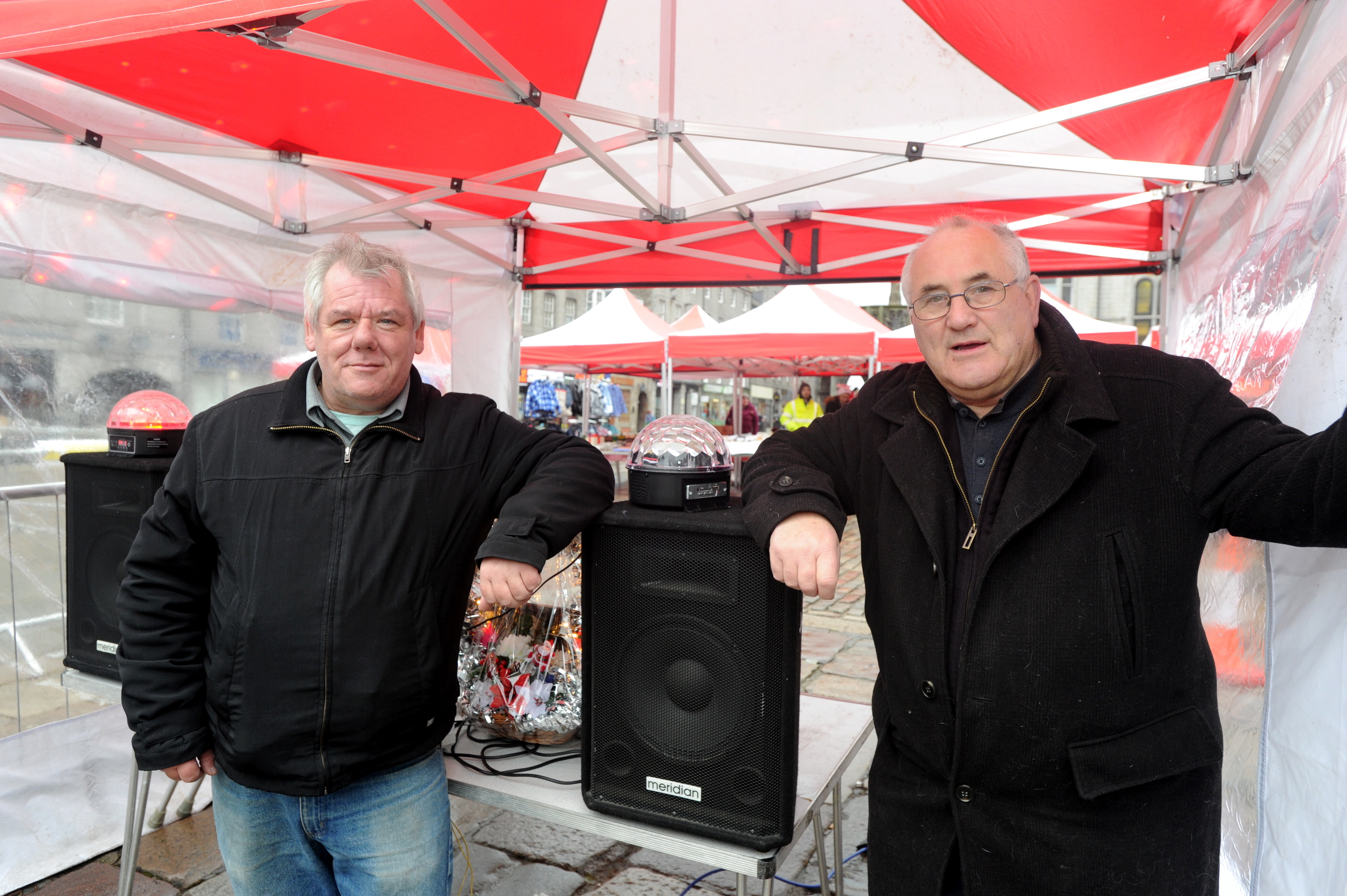 Jim Buchan and Chris Heslop at  the Castlegate market where they have been told to turn down the  music.