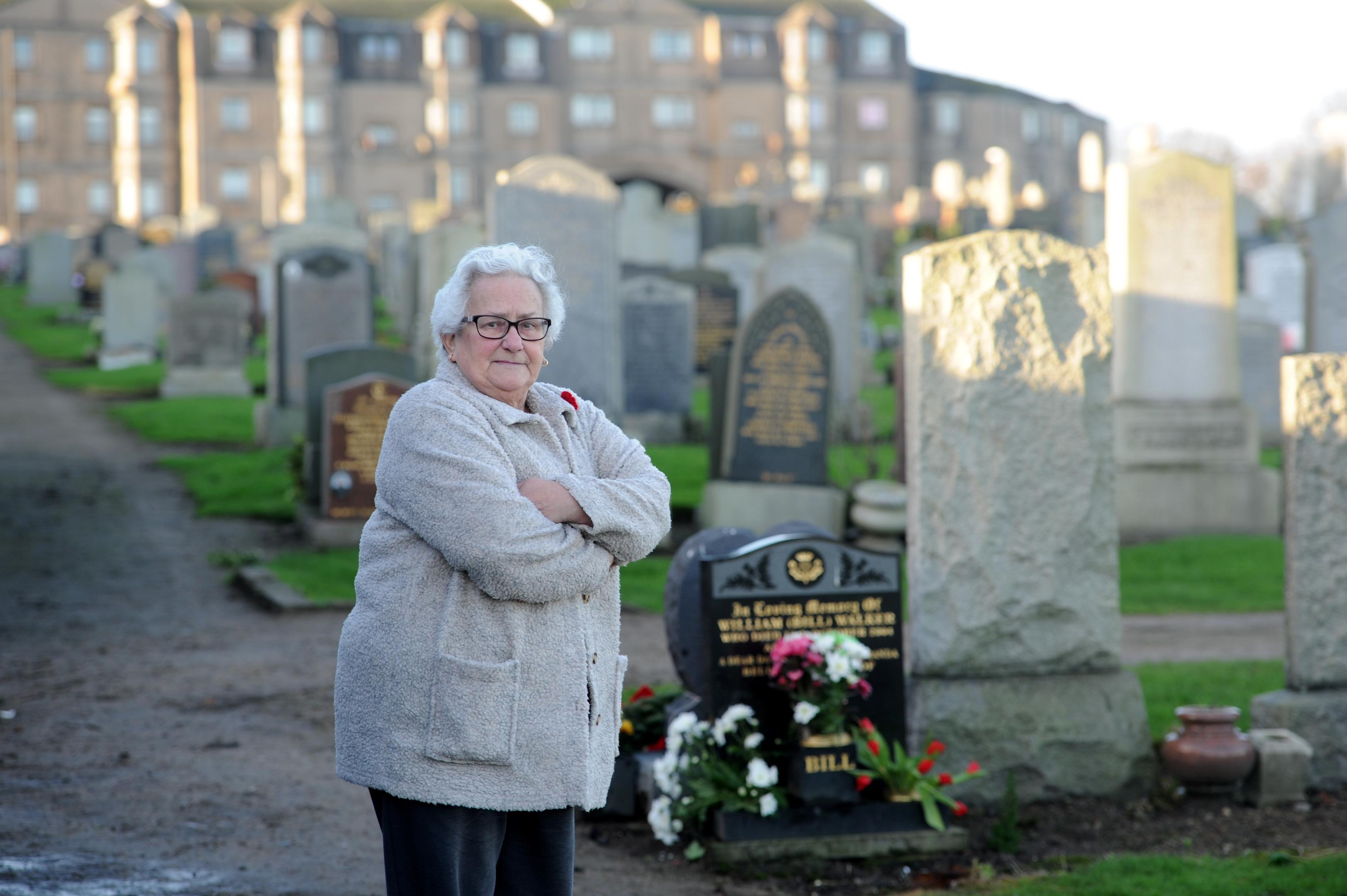 anger: Eveline Walker at her late husband's  grave.