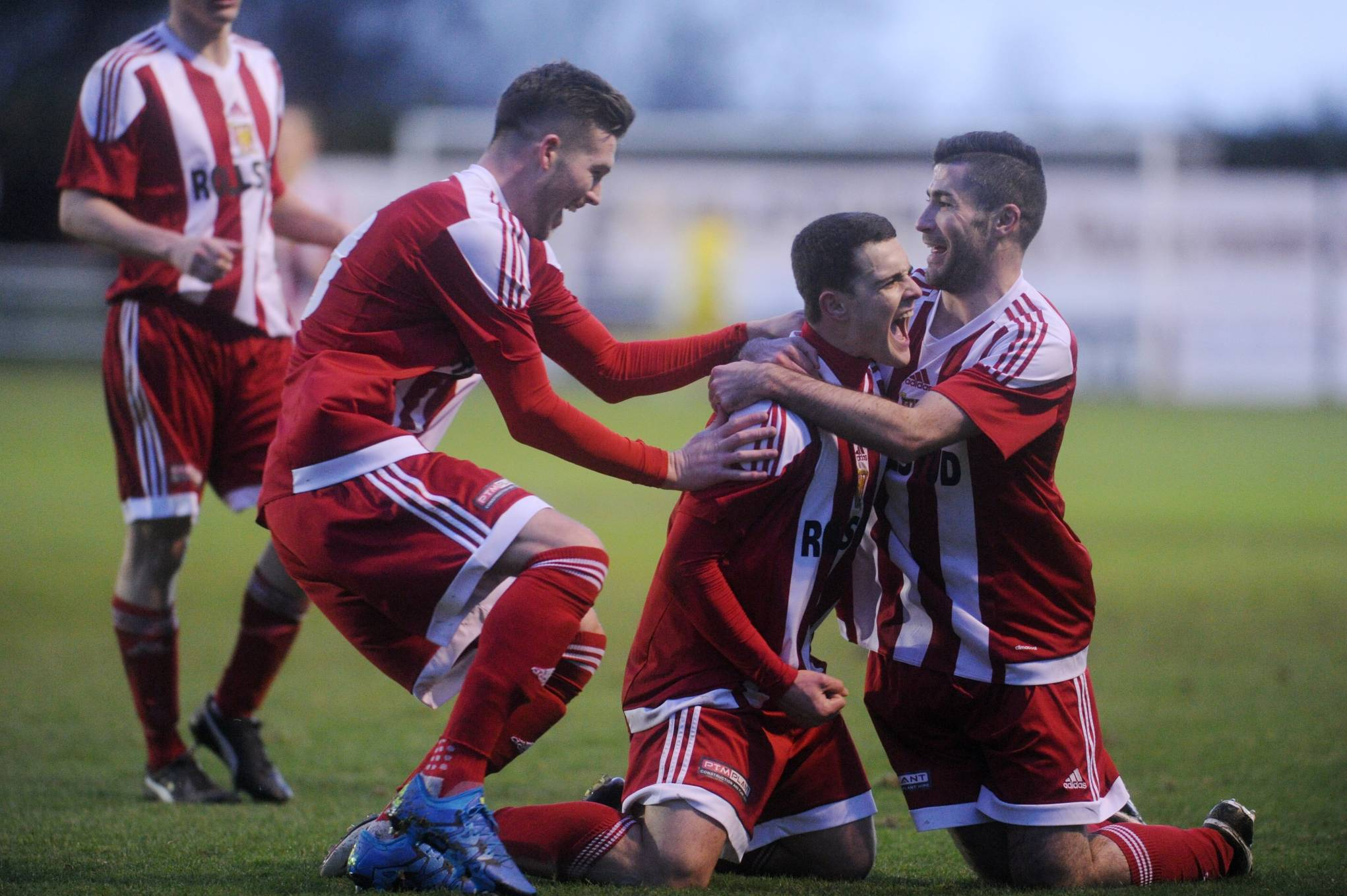 Jamie Masson, Stuart Barbour and Cammy Keith celebrating Barbour's first goal for Formartine.