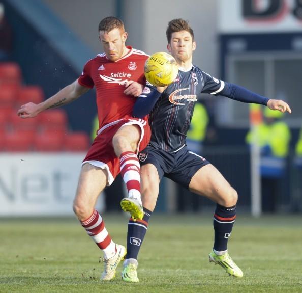 Aberdeen's Adam Rooney (left) challenges Stewart Murdoch