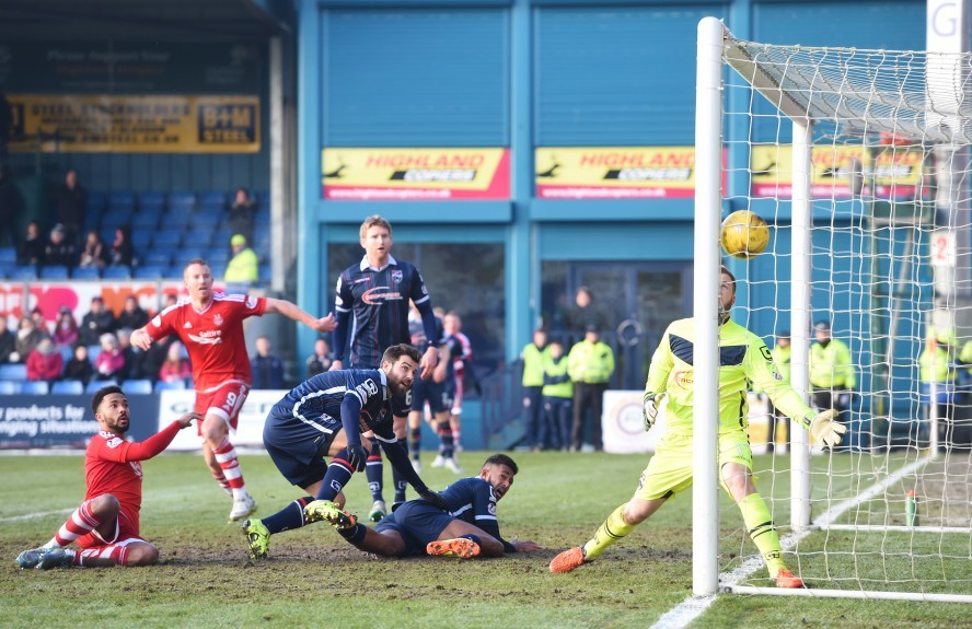 Aberdeen's Shay Logan (left) makes it 2-1.