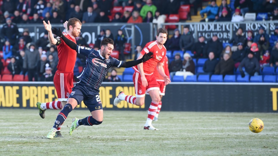 Aberdeen's Mark Reynolds (left) brings down Alex Shalk as the last man