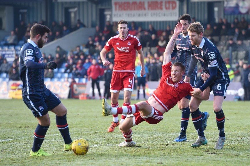 Aberdeen's Adam Rooney (centre) is brought down inside the box by Chris Robertson to earn his side a penalty