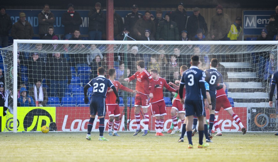 Ross County's Ian McShane (8) makes it 1-0.