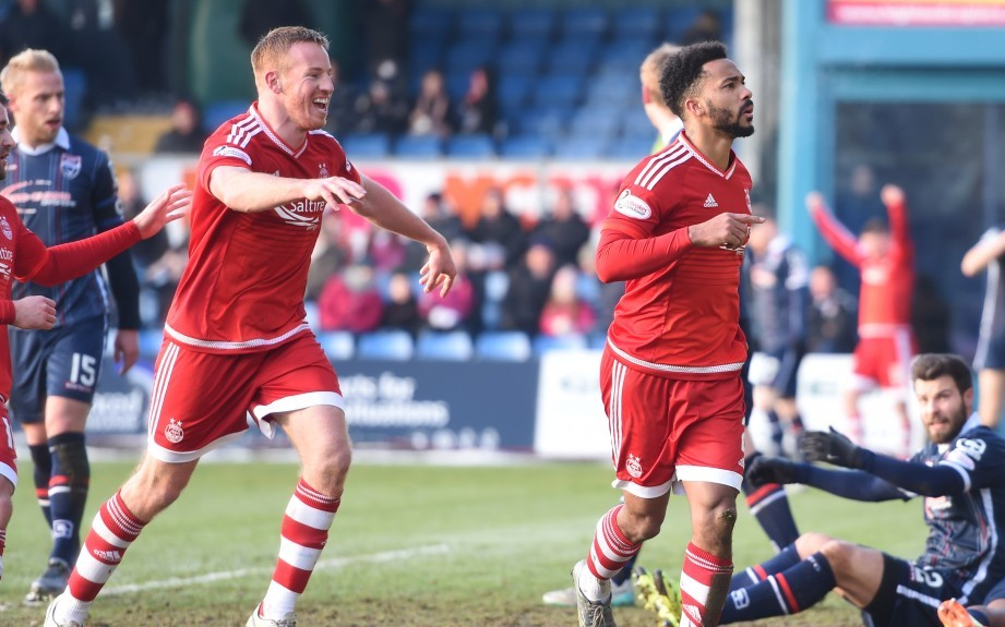 Aberdeen's Shay Logan celebrates after making it 2-1