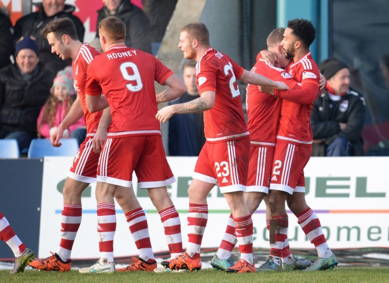 Aberdeen's Shay Logan (right) celebrates after making it 2-1