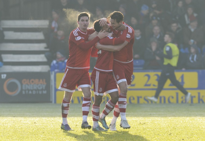 Aberdeen's Shay Logan (centre) celebrates after making it 3-1