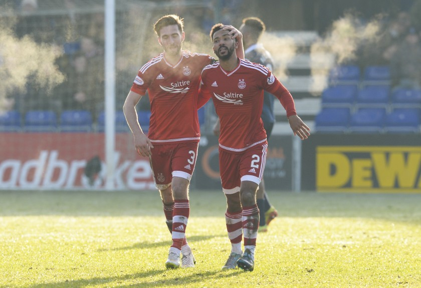 Aberdeen's Shay Logan (right) celebrates after making it 3-1