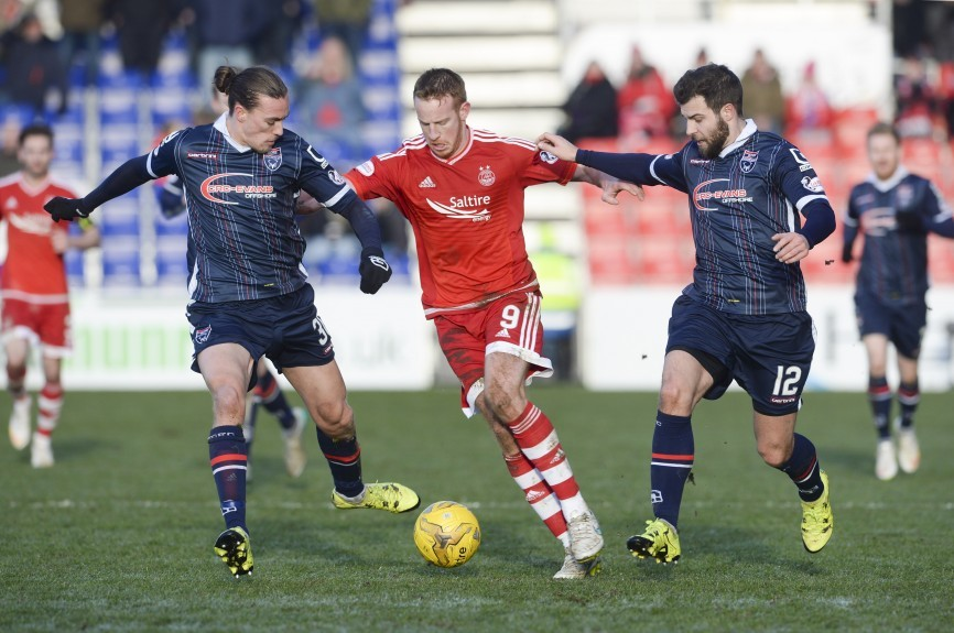 Aberdeen's Adam Rooney (centre) is challenged by Richard Foster (right) and Jasckson Irvine