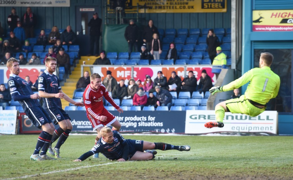 Ross County's Scott Fox (right) denies a effort from Johnny Hayes