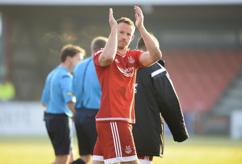 Aberdeen's Adam Rooney applauds the fans at full-time.