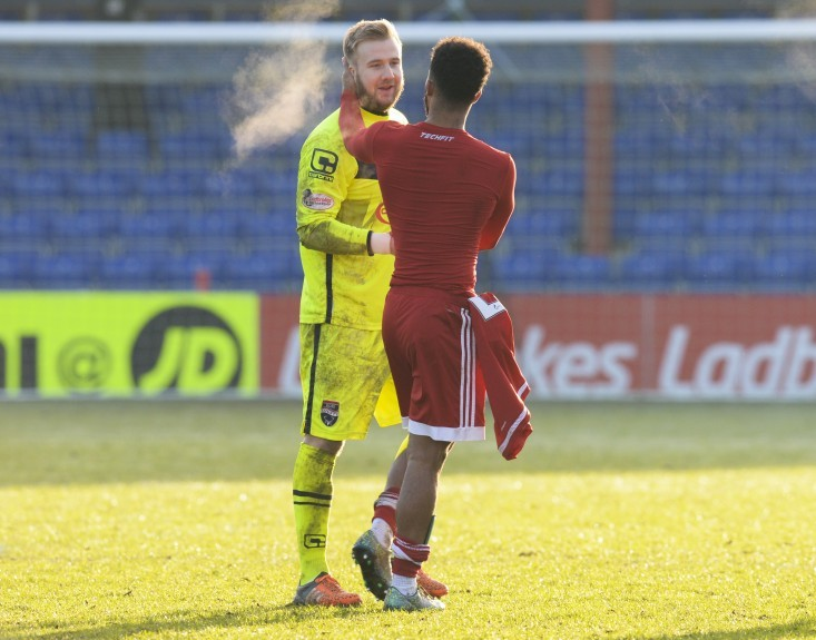 Aberdeen's Shay Logan (right) shakes hands with Scott Fox