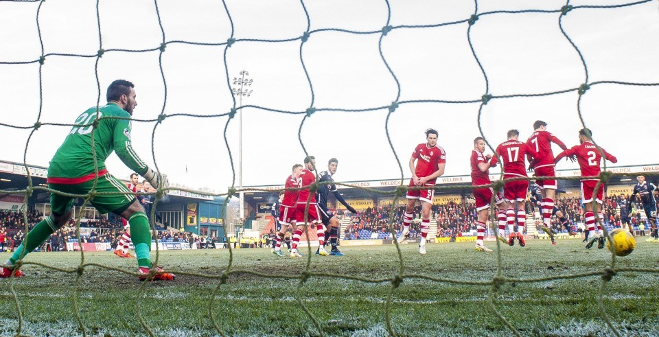 Ross County's Ian McShane (centre) makes it 1-0.