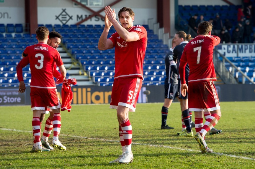 Aberdeens Ash Taylor applauds the fans