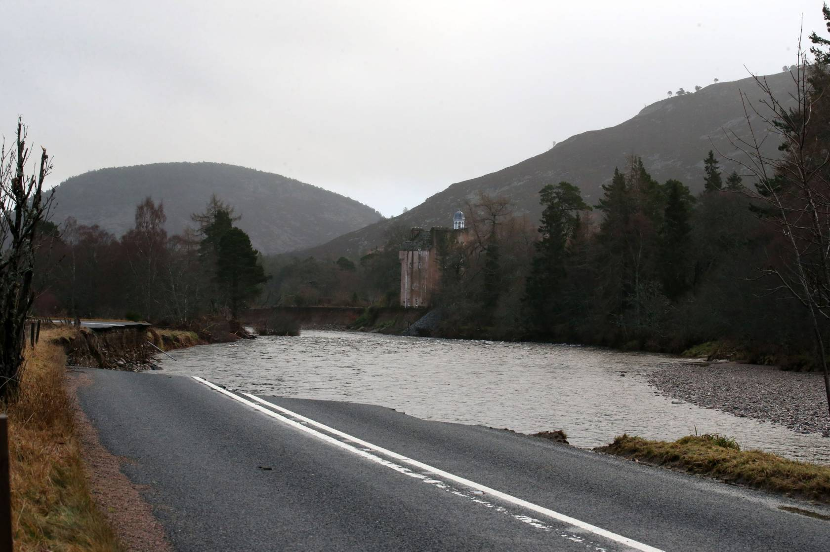 The A93 Ballater to Braemar road after the River Dee washed it away