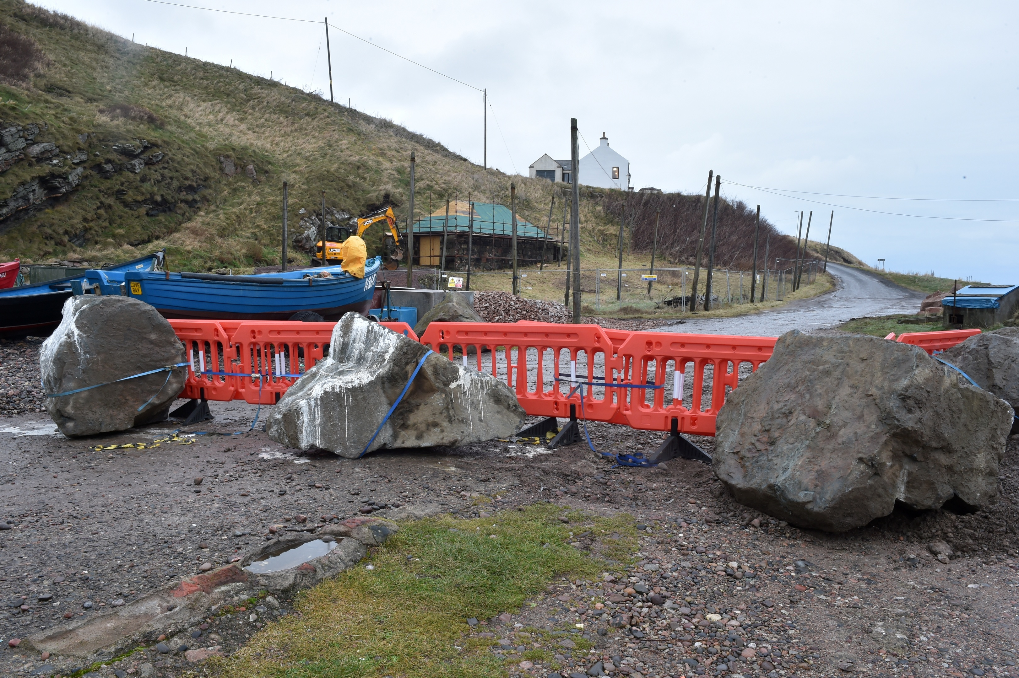 no access:  The fishermen plan a legal fight after the eviction notices and  boulders were allegedly put in place by the landowner.