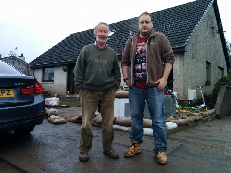 Hugh Moffat, left, and son Stuart whose home was flooded.