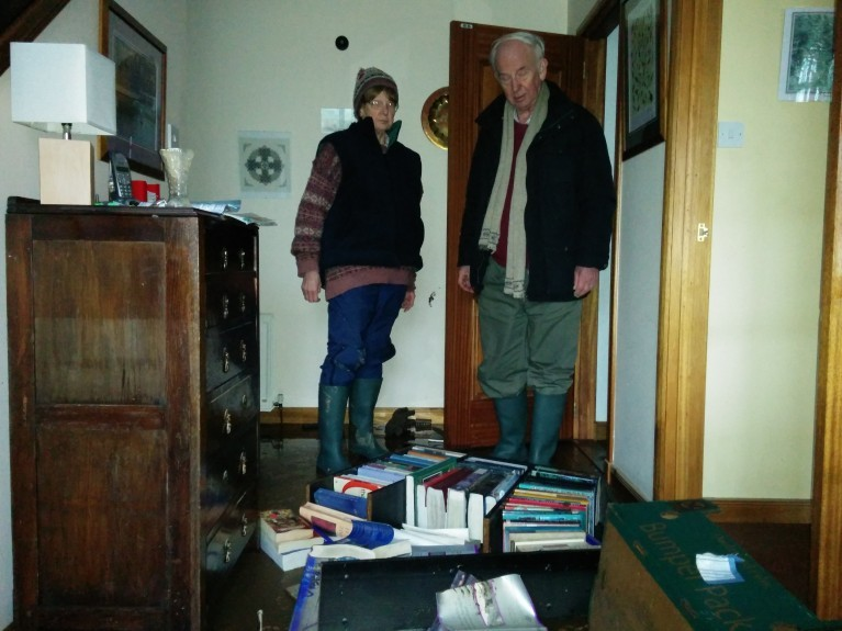 Derek and Lorna Murray look at some of the books that were spilled on to the floor of their home.