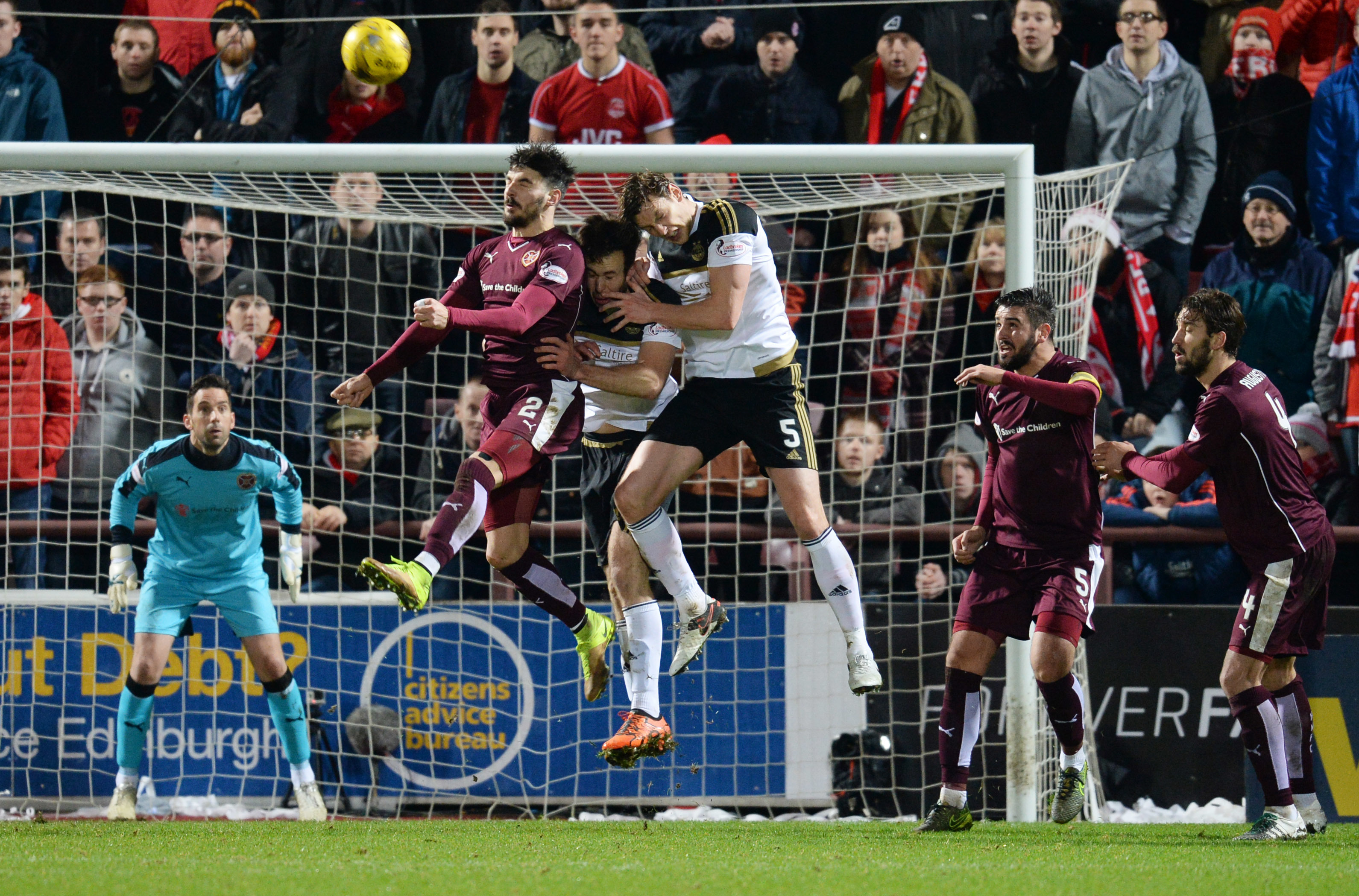 Aberdeen's Andrew Considine, third from left,  and Ash Taylor try to crowd out Callum Paterson