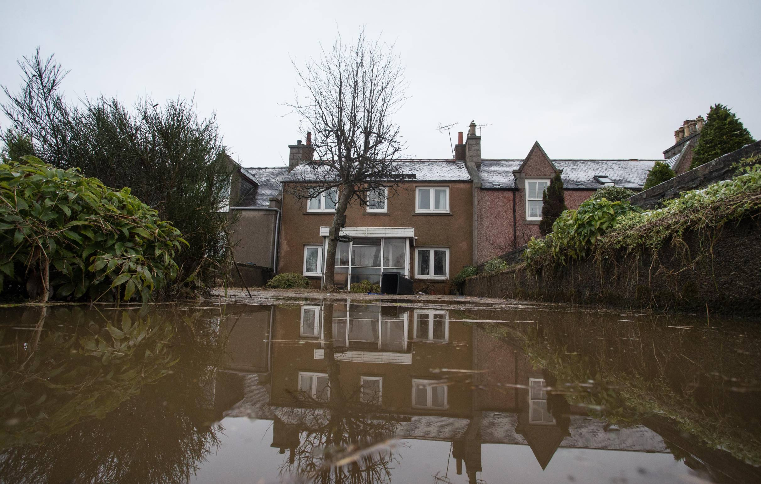 A home in Port Elphinstone is cut off by floodwater