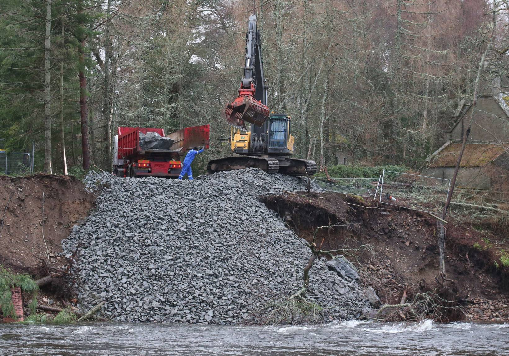 Rocks and boulders are moved to protect the shoreline on the River Dee after Abergeldie Castle came close to being washed away in storms last week.
