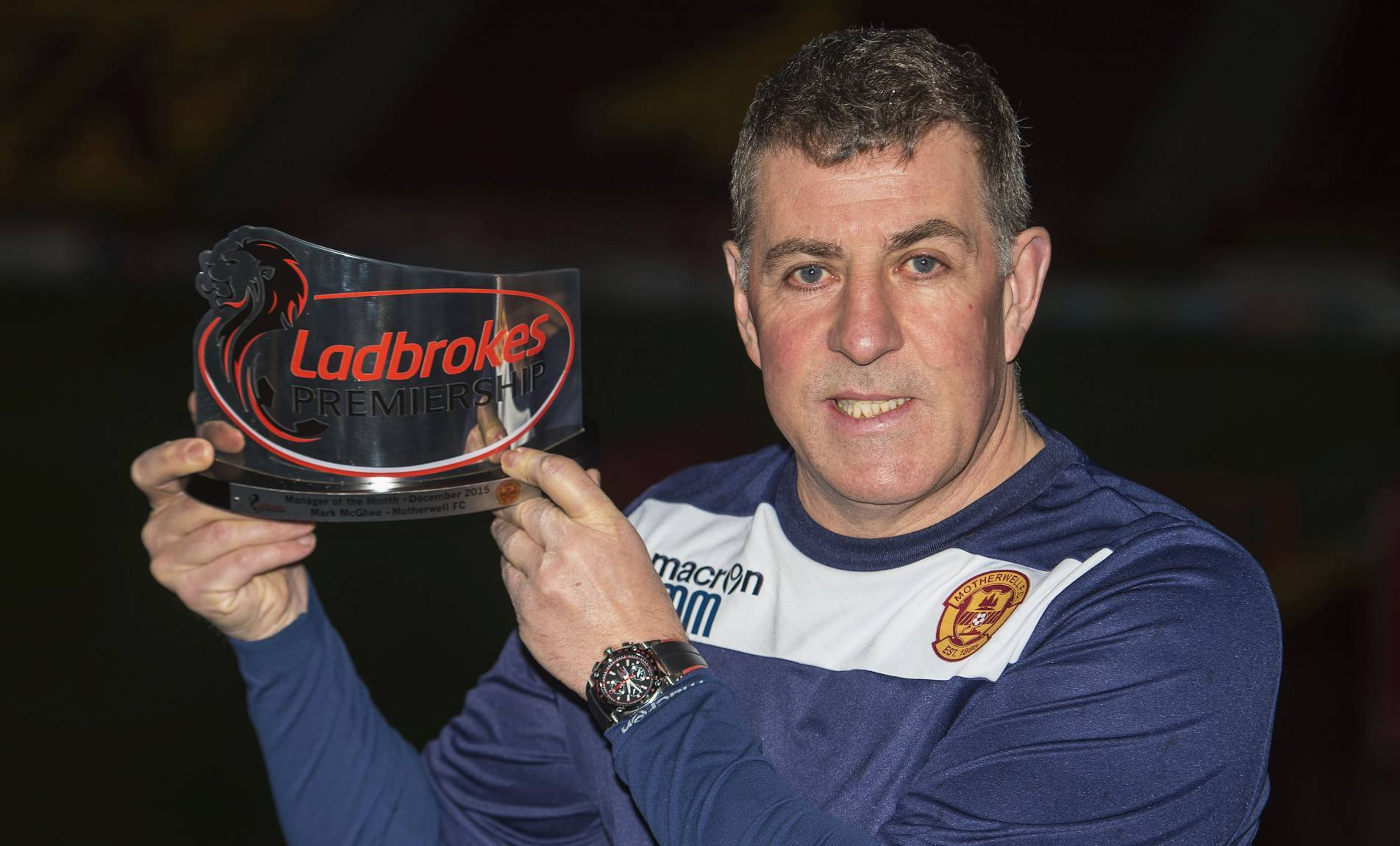 Motherwell manager Mark McGhee is presented with the Ladbrokes Manager of the Month Award