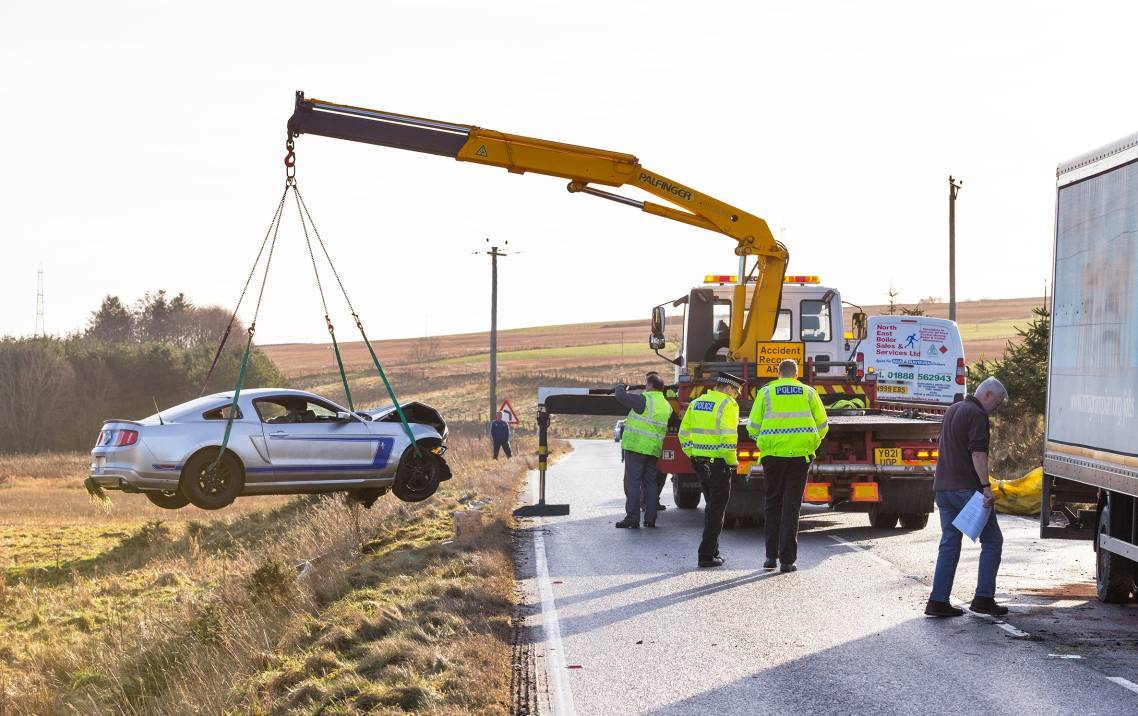 The Mustang is remove from the scene of the crash on the A947 Turriff to Fyvie road.