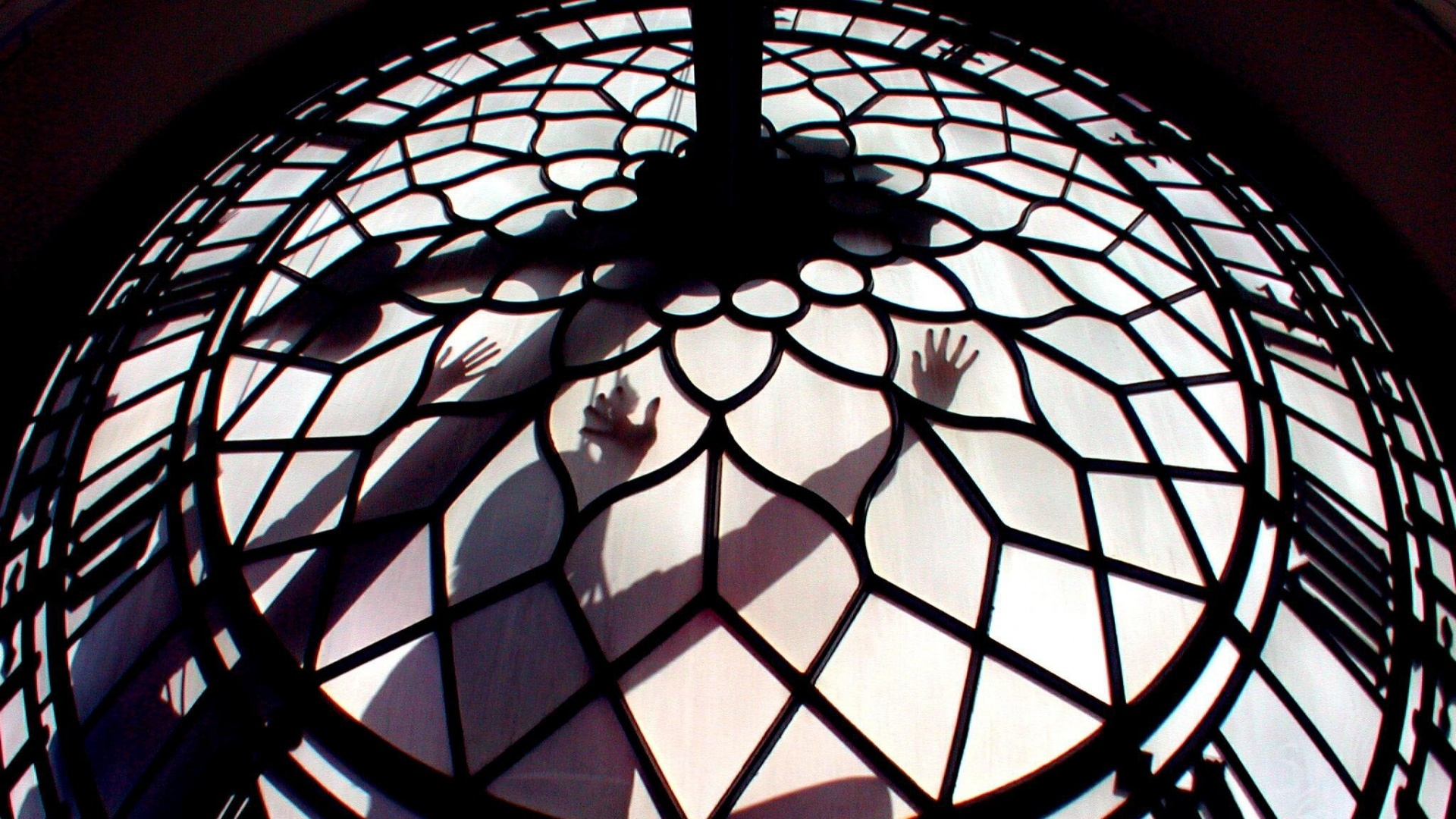 Abseilers clean one of the faces of the Big Ben clock on the tower of the Houses of Parliament in London