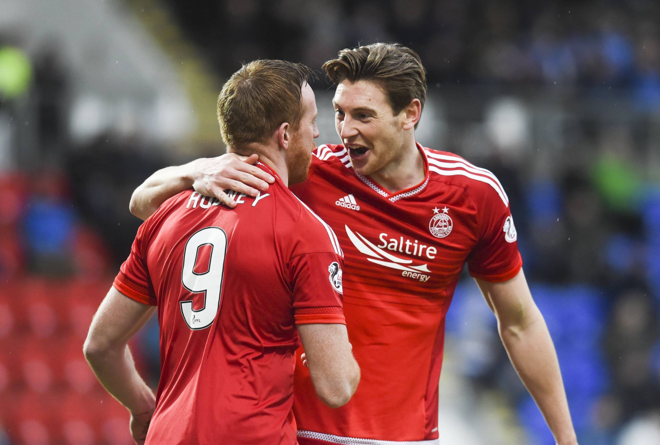 Aberdeen's Adam Rooney (left) celebrates his first goal of the game with team mate Ash Taylor.