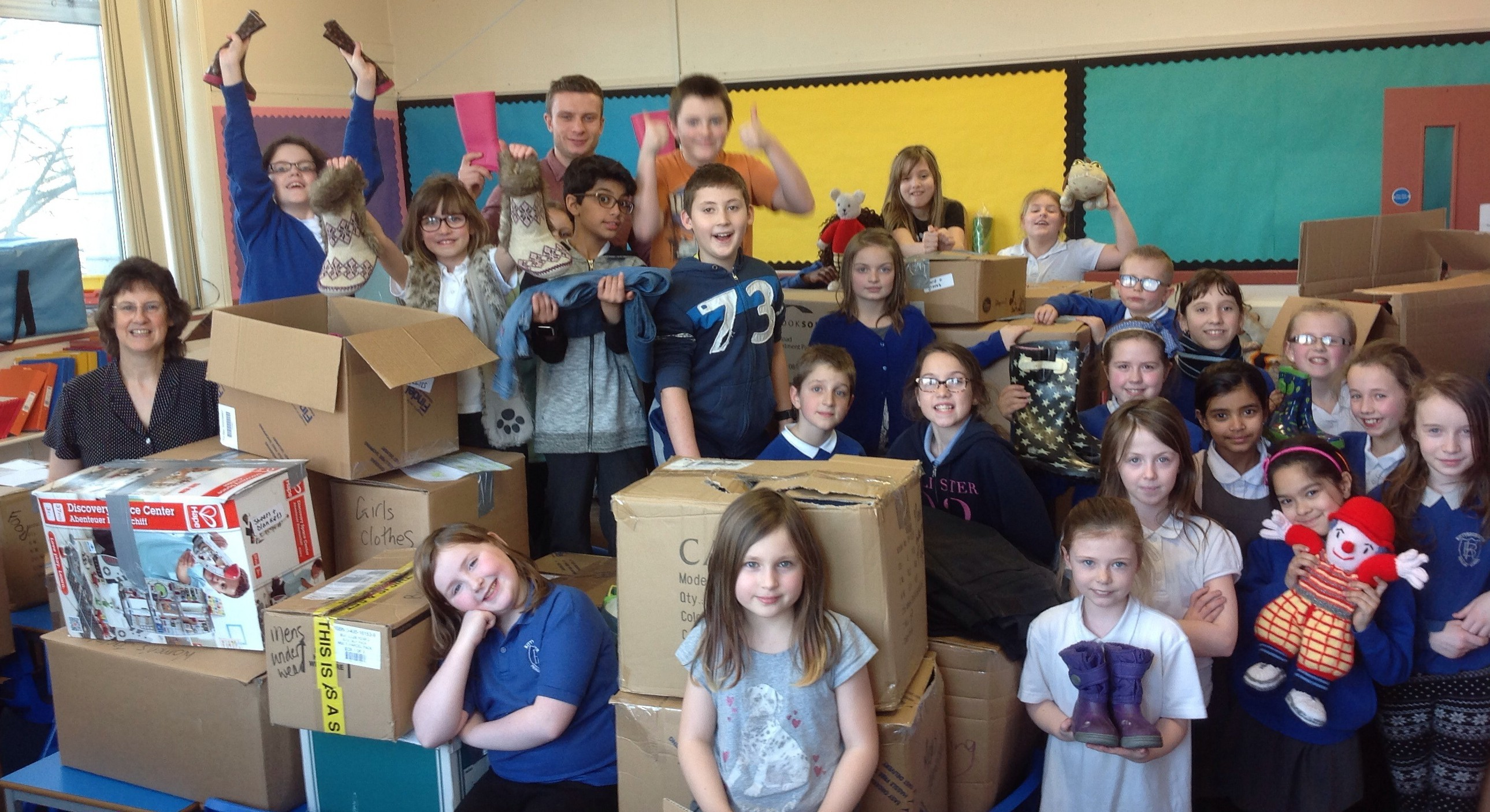 The children from Kittybrewster Primary School celebrate the 75 boxes of donations they managed to collect from the community.