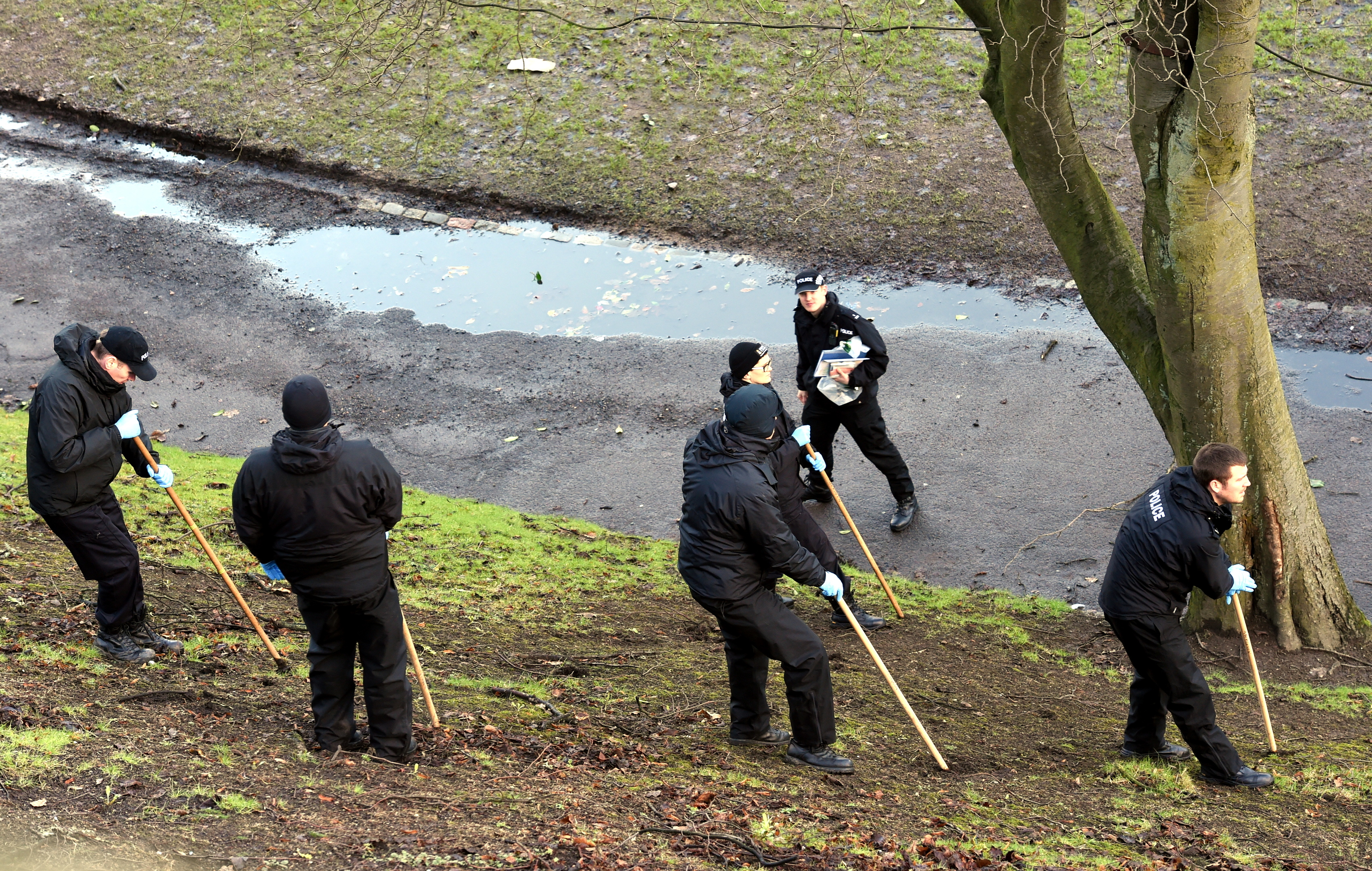 Police Scotland officers search Union Terrace Gardens the morning after the incident.