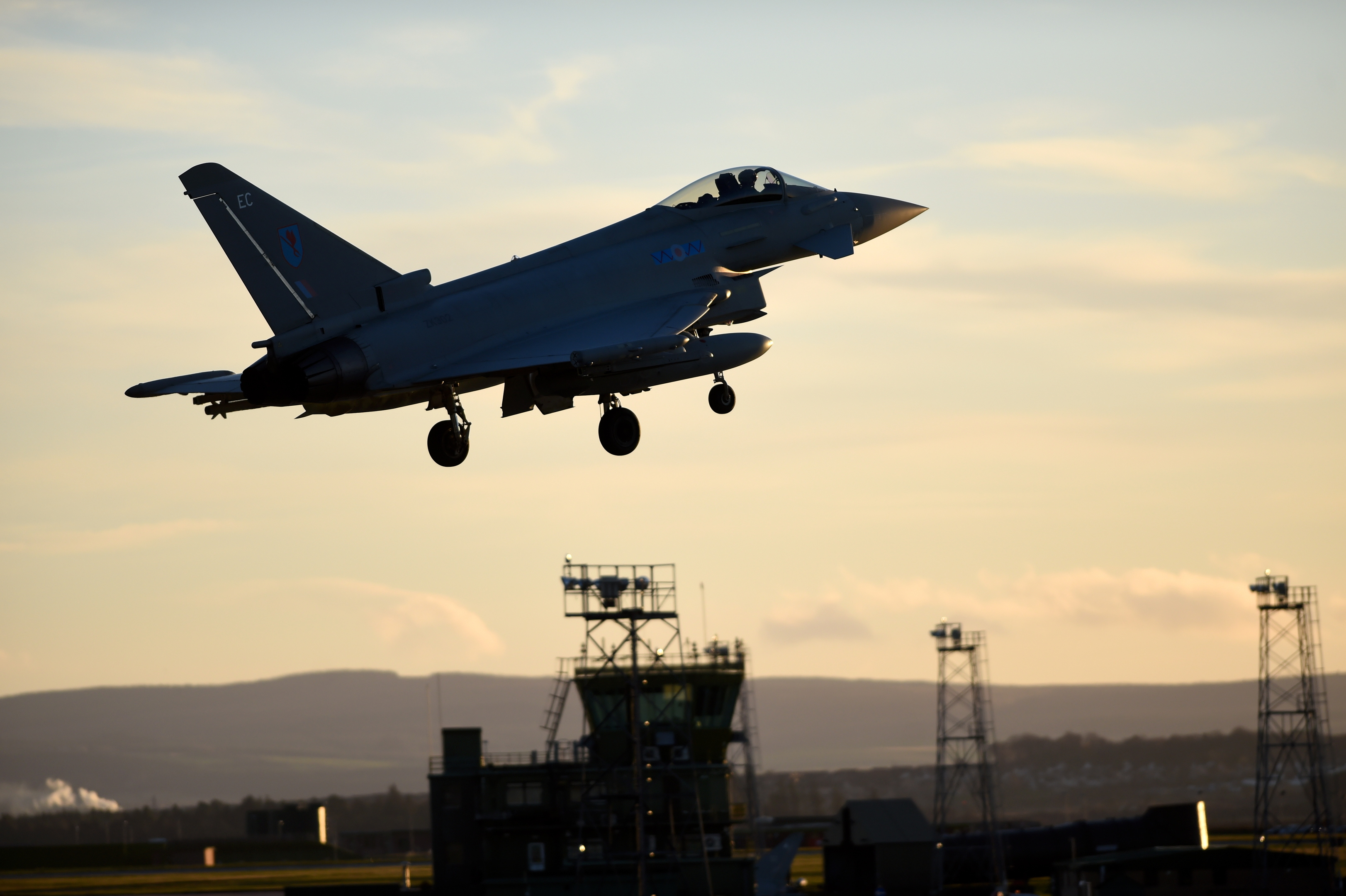 A Typhoon aircraft with its landing gear down approaches RAF Lossiemouth.