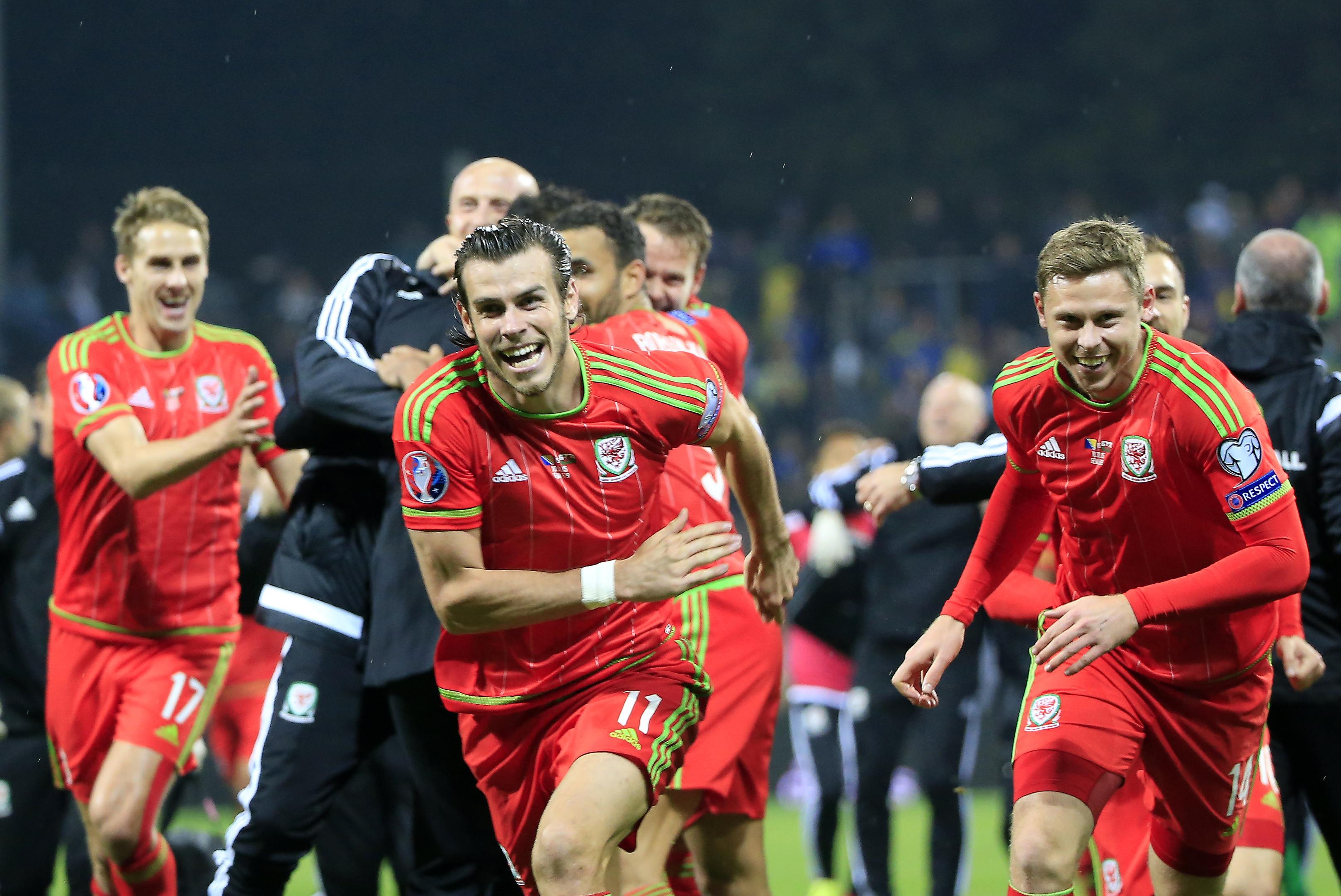Welsh pair Gareth Bale and Simon Church celebrate.