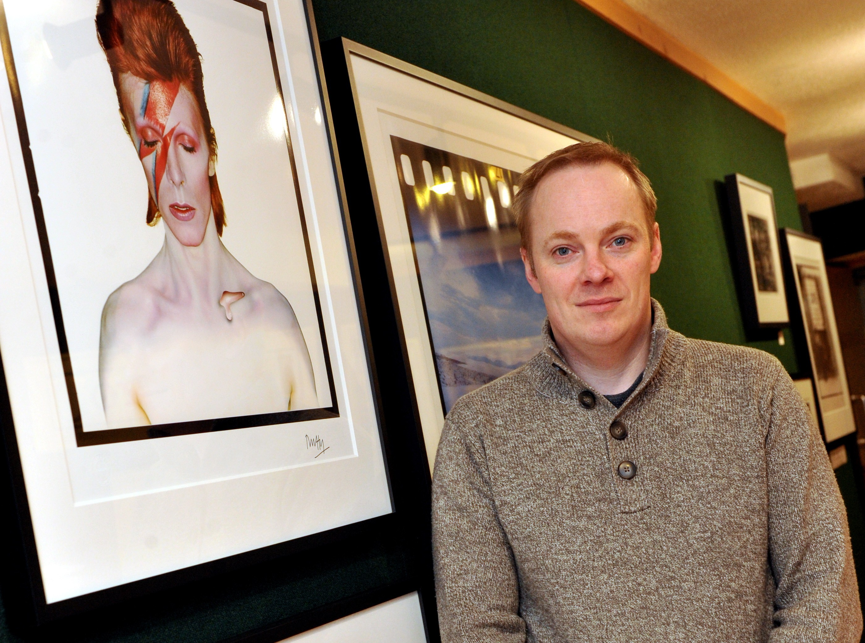 Garvan Murray of the Artists Gallery with some of the David Bowie prints.