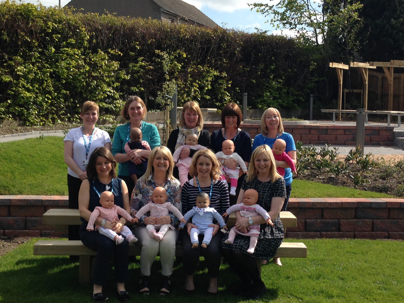 Members of the Family Nurse Partnership team in NHS Grampian, back from left, Sallyanne Crooks, Claire James, Fiona Cursiter, Gail Robertson, Shona Beattie and, front from left, Jill Mackie, Louise Murray, Karen Hudson and Sharon Clark, with the model babies.