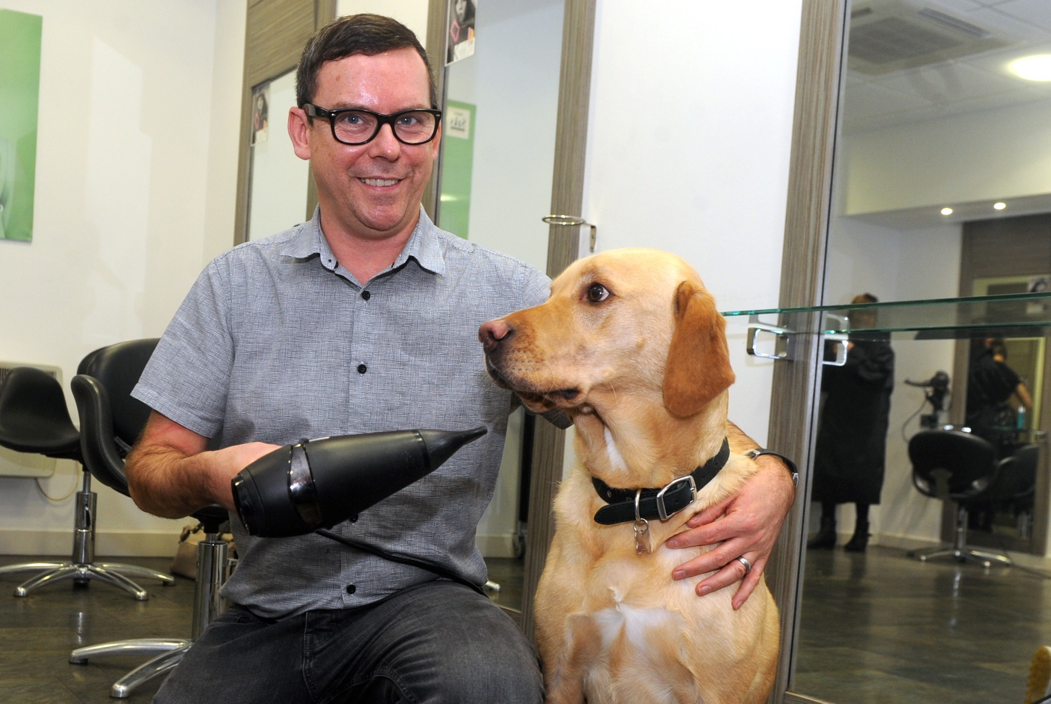 James Grant, of Saks, with his  Labrador Alfie.