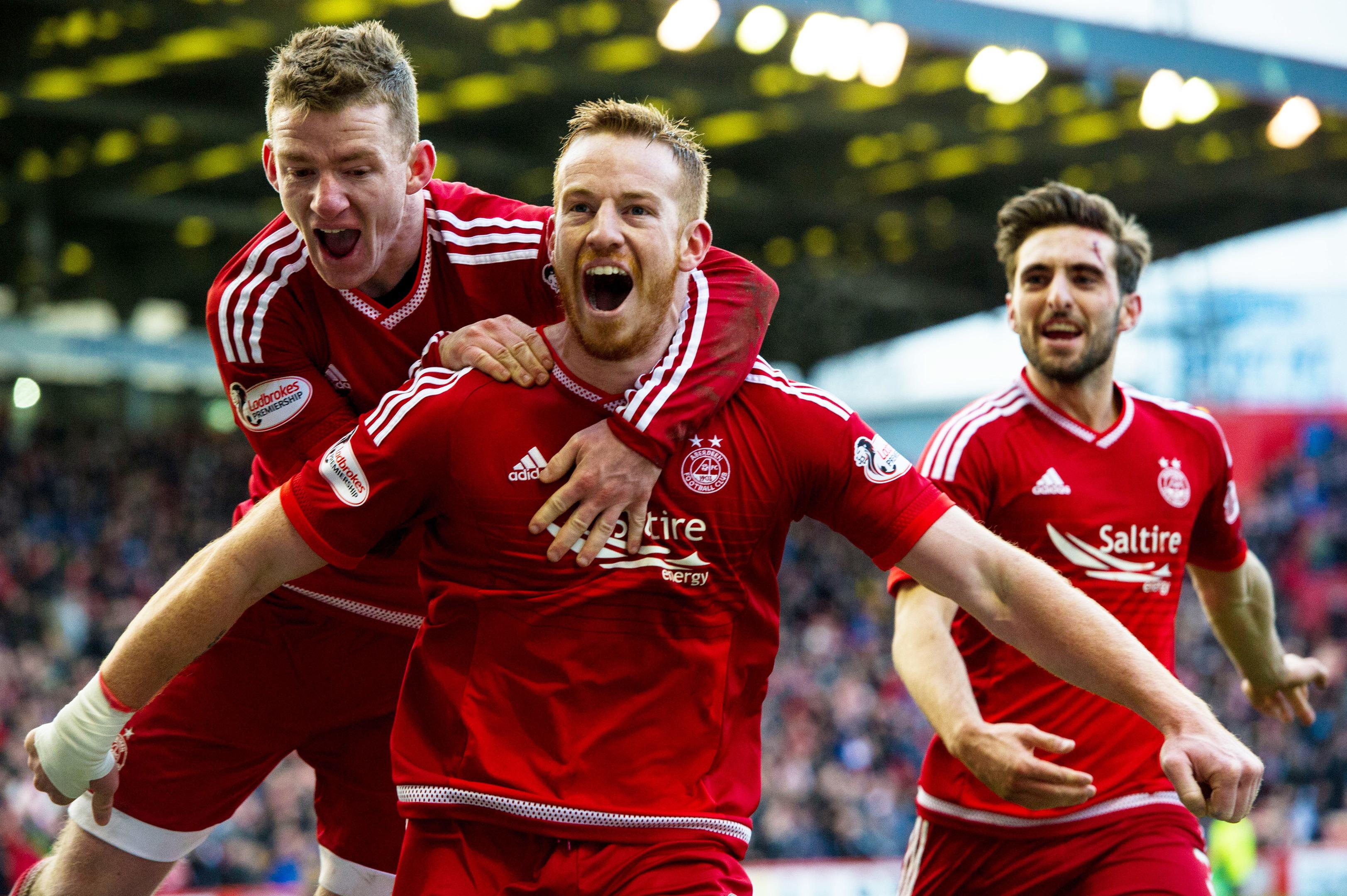 Adam Rooney celebrates his goal against Hearts in December.